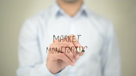 istatistik : Market Monitoring, Man writing on transparent screen