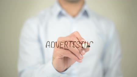 prepaid : Advertising, Man writing on transparent screen Stock Footage