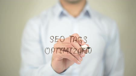 on site research : SEO Tags Optimization, Man writing on transparent screen