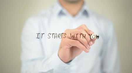 inspiração : It Starts with You, Man writing on transparent screen Vídeos