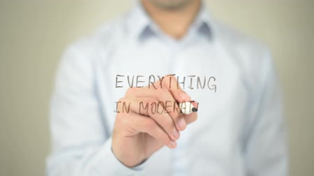 executivo : Everything In Moderation , man writing on transparent screen Stock Footage