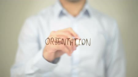 oklar : Orientation , man writing on transparent screen