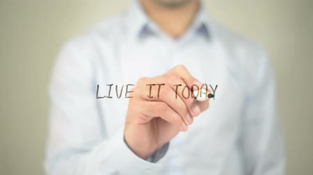 hoje : Live It Today , man writing on transparent screen Stock Footage