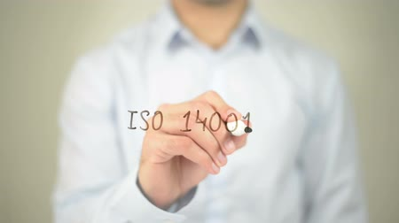 standardization : ISO 14001, man writing on transparent screen Stock Footage