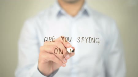 stalker : Are You Spying On Me ?, man writing on transparent screen Stock Footage