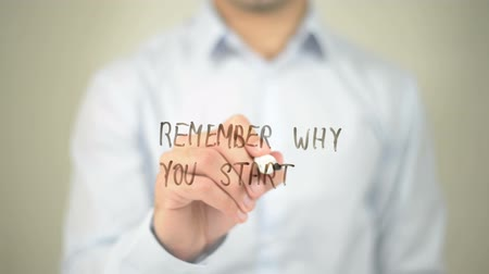 motivo : Remember Why You Started , man writing on transparent screen
