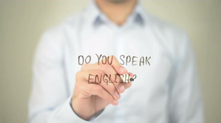 İngilizce : Do You Speak English ?, man writing on transparent screen Stok Video