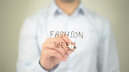 projektant : Fashion Week, man writing on transparent screen Wideo