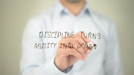 fegyelem : Discipline Turns Ability into Achievement, man writing on transparent screen