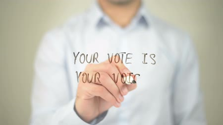 Your Vote is your Voice, man writing on transparent screen Wideo