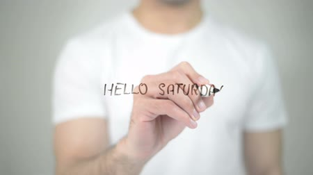 olá : Hello Saturday, man writing on transparent screen Stock Footage