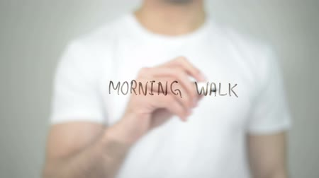 skate : Morning Walk, man writing on transparent screen Stock Footage