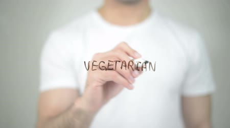 chili : Vegetarian, man writing on transparent screen Stock Footage