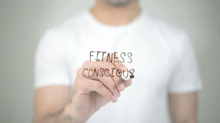 fegyelem : Fitness Consious, man writing on transparent screen