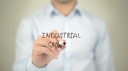 ocena : Industrial Growth, man writing on transparent screen Wideo