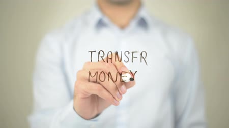 empilhamento : Transfer Money, man writing on transparent screen Stock Footage