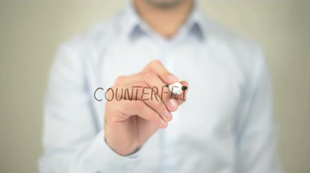 alargamento : Counterfeit , man writing on transparent screen Stock Footage