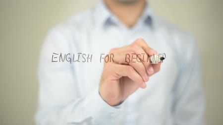 İngilizce : English For Beginners , man writing on transparent screen