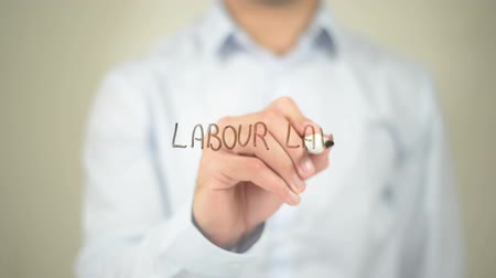 amendment : Labour Law, man writing on transparent screen