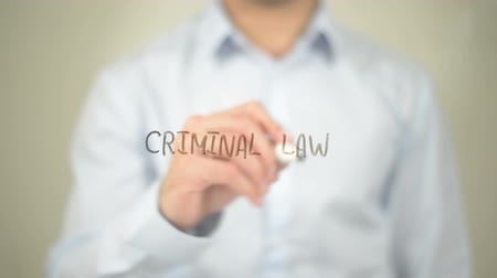 autoridade : Criminal Law, man writing on transparent screen
