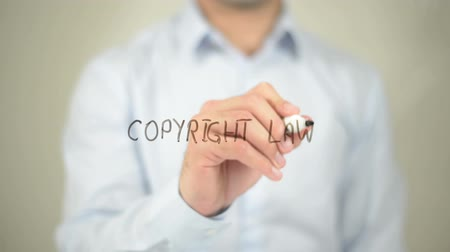 spravedlnost : Copyright Law, man writing on transparent screen