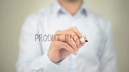 cancellation : Product Recall, man writing on transparent screen Stock Footage