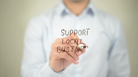 targeted : Support Local Business , man writing on transparent screen Stock Footage