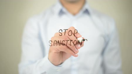 tyranny : Stop Sanctions , man writing on transparent screen