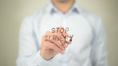 sem problemas : Stop Slavery , man writing on transparent screen Vídeos