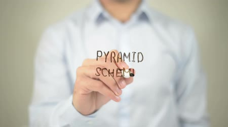 pyramida : pyramid Scheme , man writing on transparent screen