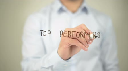 подиум : Top Performers , man writing on transparent screen Стоковые видеозаписи