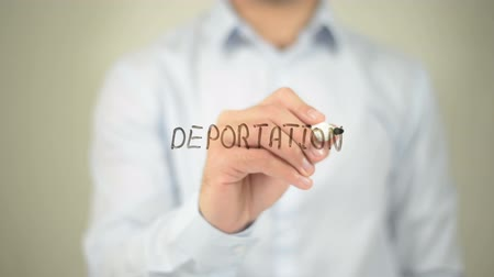 rendes : Deportation , man writing on transparent screen
