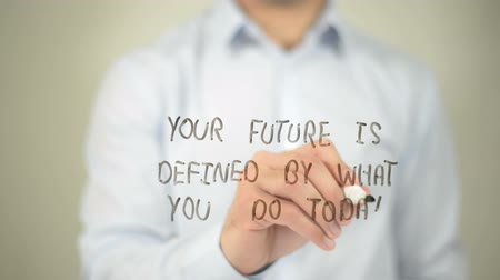 definição : Your Future Is Defined By What You Do today, man writing on transparent screen