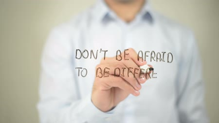 diferença : Dont Be Afraid To Be Different, man writing on transparent screen