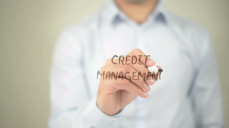 imposto : Credit Management , man writing on transparent screen Stock Footage