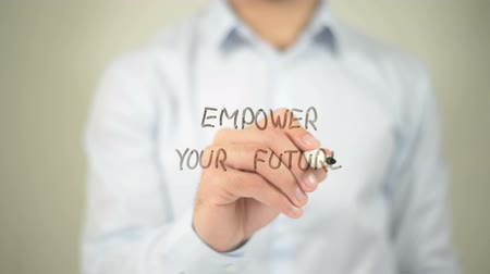 promover : Empower Your Future , man writing on transparent screen