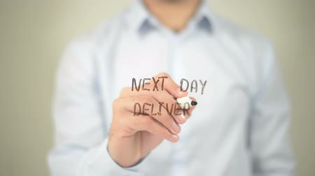 ileri : Next Day Delivery , man writing on transparent screen