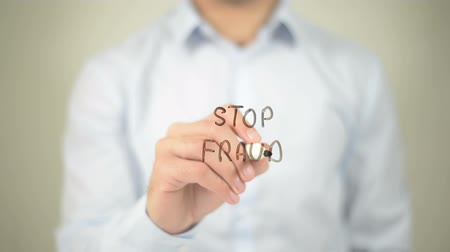 benefício : Stop Fraud , man writing on transparent screen Stock Footage
