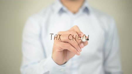 impostos : Tax Cheat , man writing on transparent screen Stock Footage