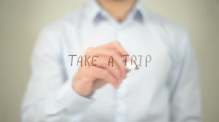 visitantes : Take A Trip , man writing on transparent screen Stock Footage
