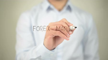 handlowiec : Forex Market , man writing on transparent screen