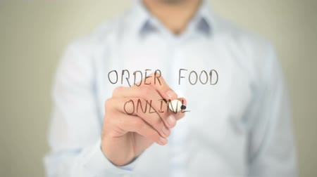 rád : Order Food Online , man writing on transparent screen Dostupné videozáznamy