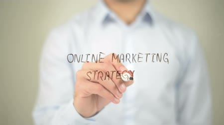optimalizace : Online Marketing Strategy , man writing on transparent screen