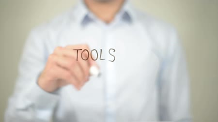 toolbox : Tools , man writing on transparent screen