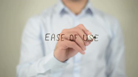 utilidade : Ease To Use , man writing on transparent screen Stock Footage