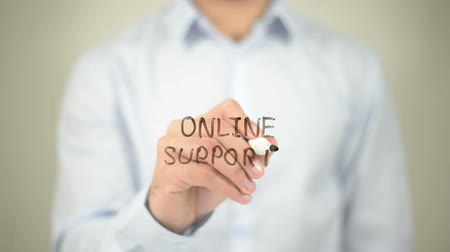sete : Online Support, man writing on transparent screen Stock Footage