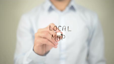 cartografia : Local Map, man writing on transparent screen Stock Footage