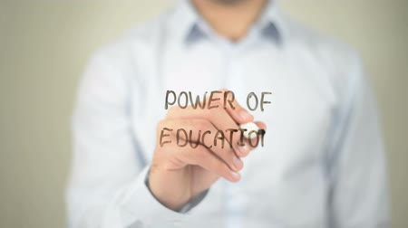 enrolado : Power of Education, man writing on transparent screen Stock Footage