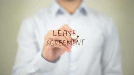agreement : Lease Agreement   ,  man writing on transparent wall Stock Footage