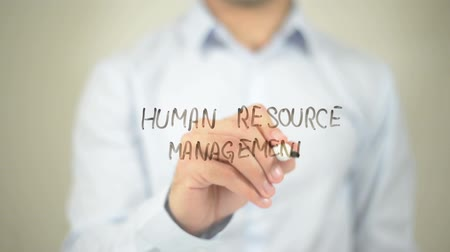 recursos : Human Resource Management   ,  man writing on transparent wall